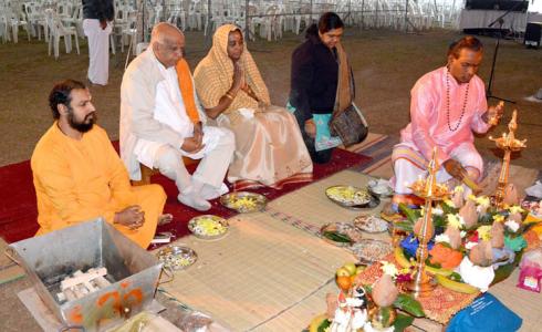Brahmachari Abhijit Chaitanya along with devotees performing Hanumanji pooja before the Havan